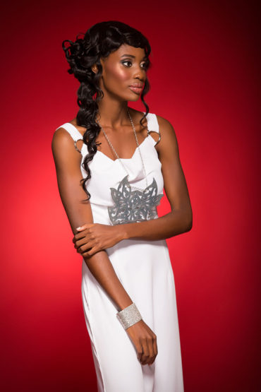 Grecian Goddess Beach wedding perfection! White Grecian dress with flowing cape and tribal galvanize necklace with adjustable strap, by The Lush Kingdom. Swarovski cuff and crystal stud earrings from Stechers Fine Gift Stores. Silver-strap sandals by Jebelle. Model: Brettney Romeo