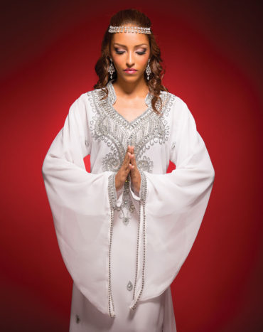 Embellished Bride White Shalwar with silver embroidery and diamante embellishments, Yellow Bird Enterprises. Crystal chandelier earrings, Stechers Fine Gift Stores. Swarovski crystal headpiece from Hijaab Pins by Unique Swarovski Designs. Model: Maria Elena Marquez